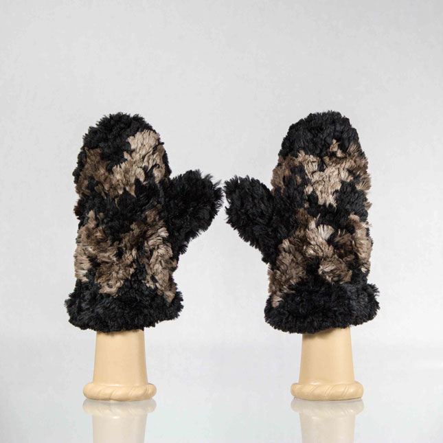 Black knit beaver mittens with natural brown cheveron